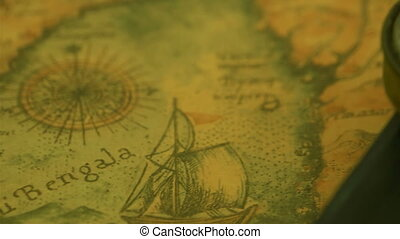 A compass on top of the edge of the bible under it is a...