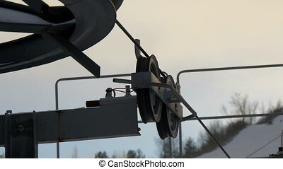 The rollers and pulleys of the mechanical ski lift of the...