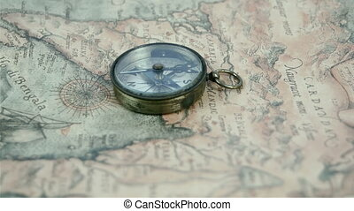 A compass in the middle of the map with its second arrow...