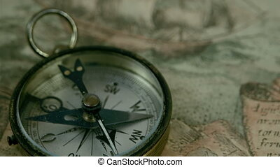 The compass lying on the map with the navigational map...