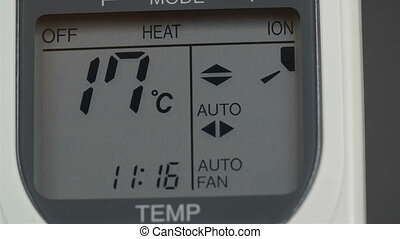 Screen of an aircon machine with temperatures going up from...