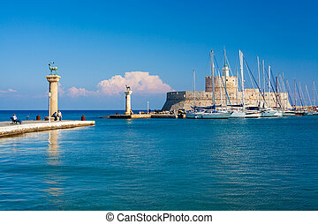 Entrance to Mandraki Harbour Rhodes - Deer statues and the...