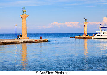 Entrance to Mandraki Harbour Rhodes - Deer statues at the...