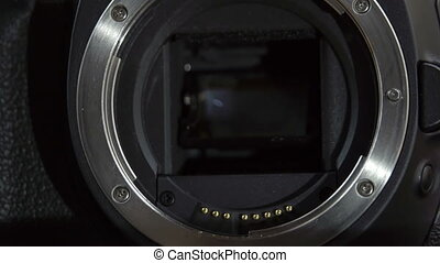 Camera lens holder where lens is attached It is a dlsr...
