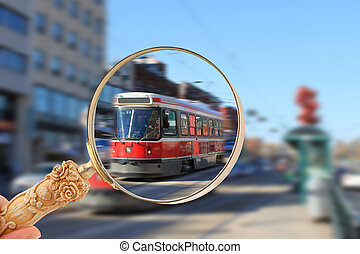 Toronto streetcar transportation - Magnifying glass looking...