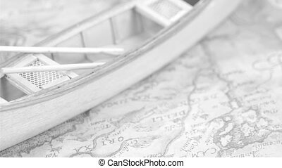 A white canoe boat on the map It is a rotating view of the...