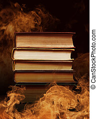 Hardcover books with swirling smoke - Pile of hardcover...