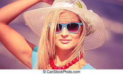Beautiful blonde girl in hat on beach - Fashion, happiness...