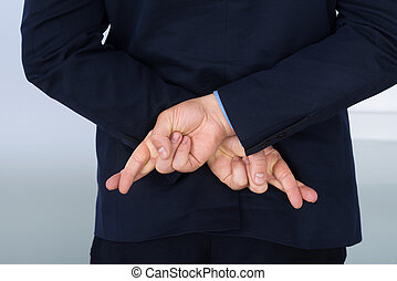 Businessman With Finger Crossed - Businessman Standing With...