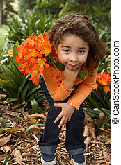 Young girl with a bunch of lilies