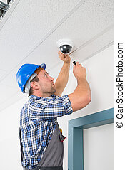 Technician Adjusting Cctv Camera - Close-up Of A Technician...