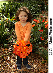 Girll with a bunch of clivia from the garden