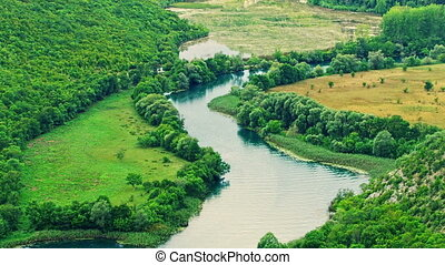 Krka river meadows - Green meadows by the Krka river in a...