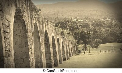 Ancient aqueduct tropical Jamaica - Historic arches seaside...