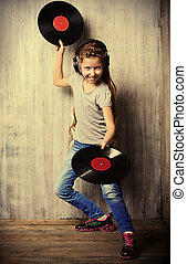 dance with vinyl record - Cute happy teen girl enjoys the...