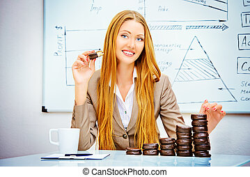 chocolate income - Beautiful businesswoman posing with...