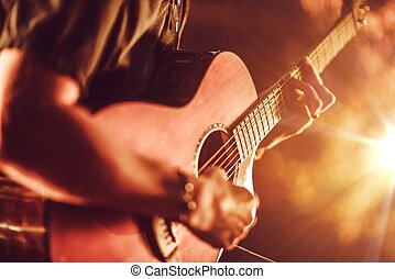 Acoustic Guitar Playing. Men Playing Acoustic Guitar Closeup...