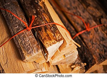 Firewood Bundles - Bundles of Pine Firewood Closeup Photo....