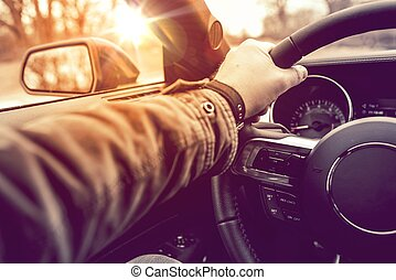 Hand on Wheel Car Driving. Driving Modern Car Steering Wheel...