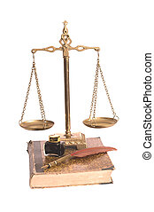 Justice scales, feather with an inkwell and the old book