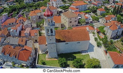 Sutivan town church on Brac Island, aerial shot - Copter...