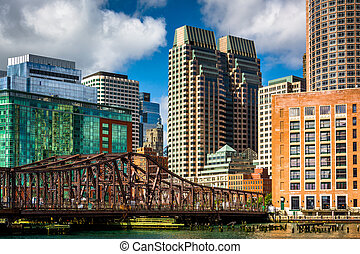An old bridge over Fort Point Channel and buildings in...