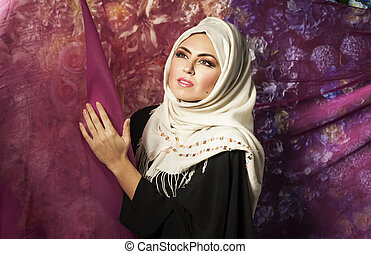 Muslim woman in a traditional dress - young mysterious...