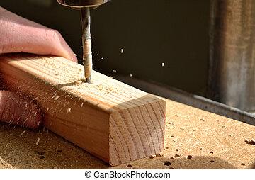 With drill working - Mit Bohrmaschine wird Loch in Holz...