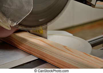 By sawing wood piece with miter saw - Mit Kappsaege...