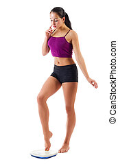 Young sporty girl with scales isolated