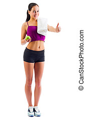 Young sporty girl with apple isolated