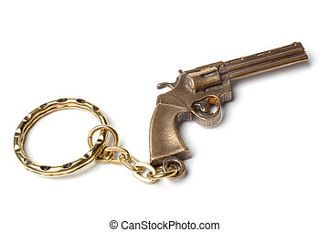 Trinket for the keys as a revolver on a white background