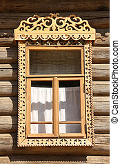 Old window of russian wooden house, a vertical picture