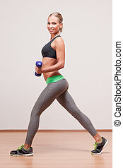 Gorgeous young fitness woman. - Portrait of a gorgeous young...