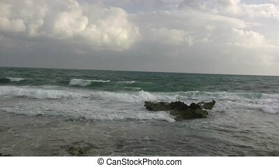 Short Rocky Wave Break - Ocean waves clash over a shore reef...