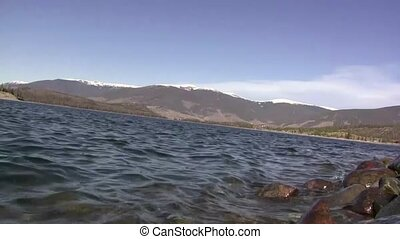 Lake Shore Waves With Mountain Back - Shot taken from the...