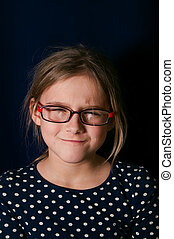 Girl Getting Angry - Portrait of a young girl with...