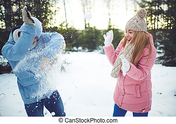 Playing snowballs - Happy young dates playing snowballs...