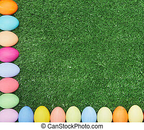 Eggs and grass - Two crossing lines of painted eggs making...