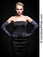 Blonde woman in black dress - Young blonde woman in black...