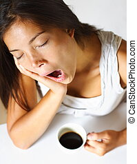 Woman tired - young woman drinking coffee in early morning,...