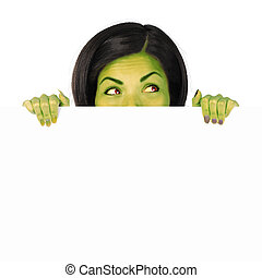 Halloween sign blank with copyspace - witch woman holding...