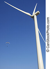Fly - Paraglide and wind mill with blue sky
