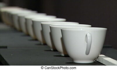 White porcelain cups in a row