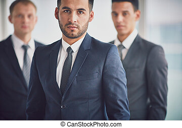 Business leader - Confident business leader looking at...