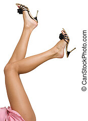 Sexy and funny legs in black shoes on a white background