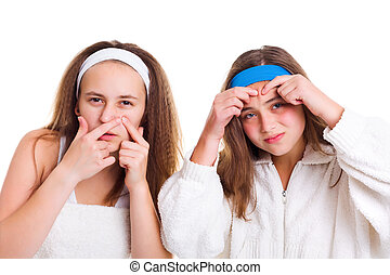 Teenagers skin problem concept: girls squeezing pimples