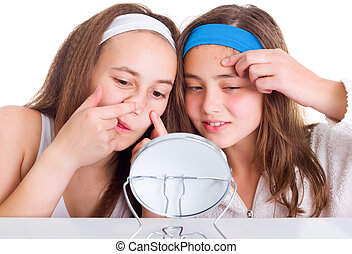 Girls searching for blemishes on theirs skin - Teeneger...