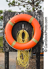 Orange Life Ring and Yellow Rope