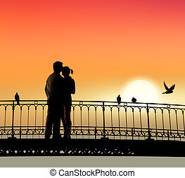 bridge of sweethearts - silhouette of bridge and pair of...
